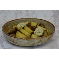 Aardappelpartjes in schil met kruidenboter
